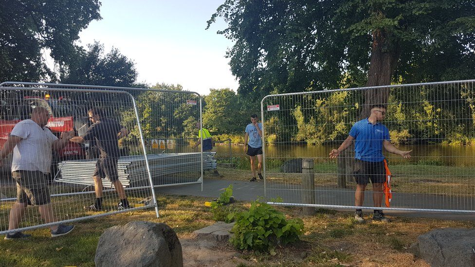 Fencing being erected at the riverside