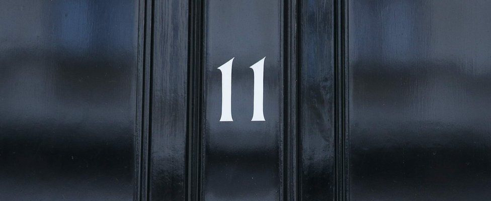 Image shows the front door of 11 Downing Street, the official residence of the Chancellor of the Exchequer