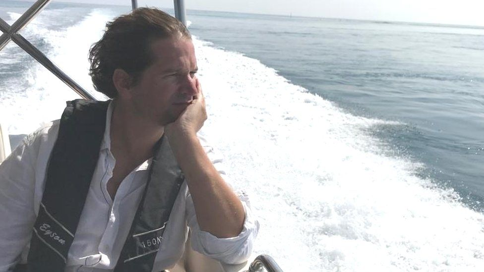 Edward Anderson on a boat