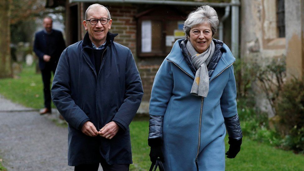 Prime Minister Theresa May and her husband Philip leave church