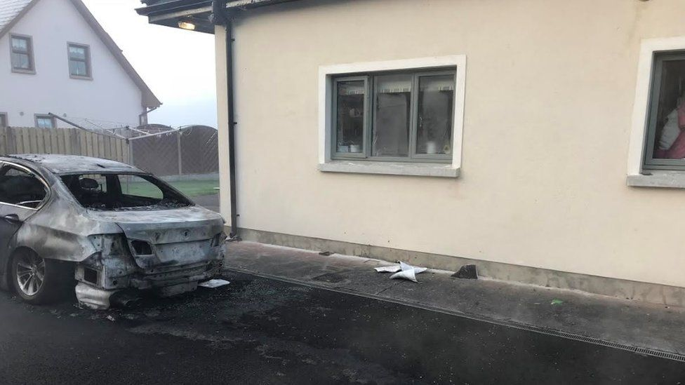 The car was set on fire outside the family's bedroom
