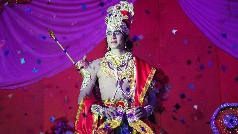 An Indian artist dressed as Hindu God Rama performs during a production of the traditional drama 'Ramleela', narrating the life of Rama