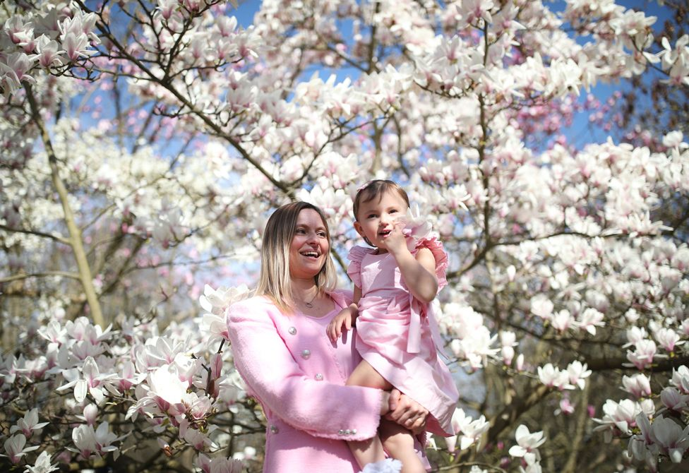A mother and daughter enjoy warm weather in Kew Gardens, London on 30 March 2021
