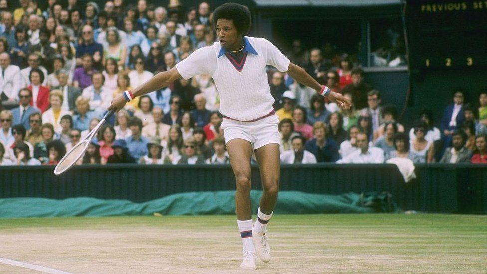 US tennis player Arthur Ashe playing at Wimbledon in London, the UK