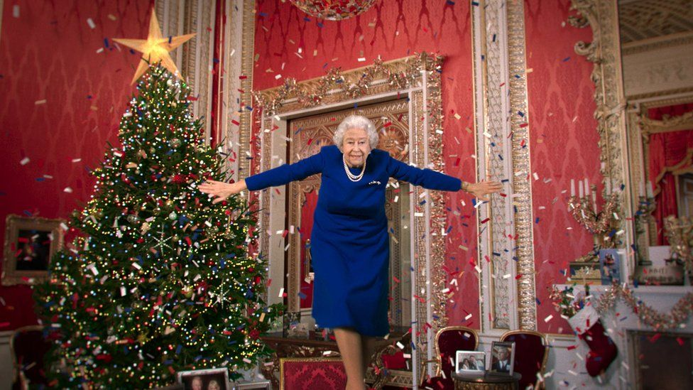 An image apparently of the Queen dances on a table in Channel 4's Christmas message