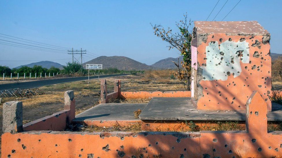 Bullet holes are seen after a battle between the CJNG and Los Viagras cartels in Aguililla