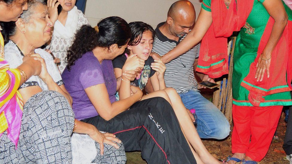 Family members and relatives of 55-year-old Gauri Lankesh, who was shot dead by unknown assailants in the porch of her home in Bangalore mourn her death overnight