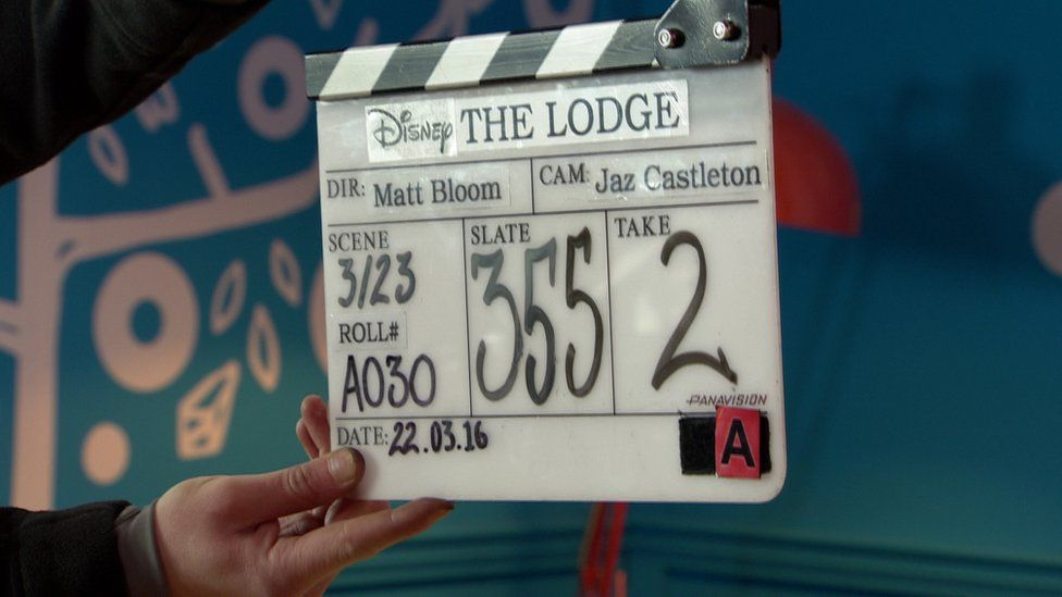 A clapperboard detailing scene notes on the set of The Lodge