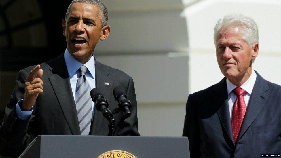 US President Barack Obama speaks as former President Bill Clinton listens at the White House in Washington DC - 12 September 2014