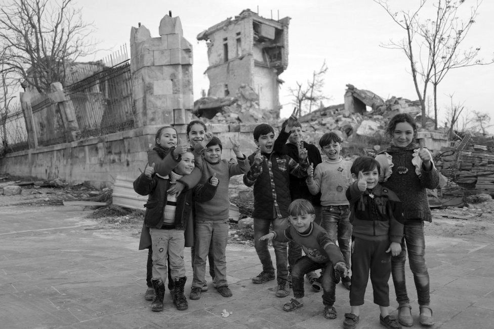 Children pose for a photo in Aleppo