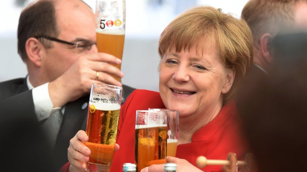 German Chancellor Angela Merkel (c) drinks beer during the 500th anniversary ceremony of the German Beer Purity Law (Reinheitsgebot) in Ingolstadt, Germany (22 April 2016)