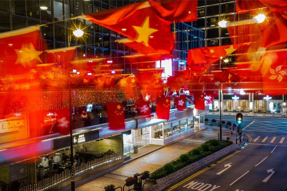 Chinese and Hong Kong flags are seen ahead of Chinese President Xi Jinping's arrival in Hong Kong for the 20th anniversary of the handover from Britain to China on June 28, 2017 in Hong Kong, Hong Kong