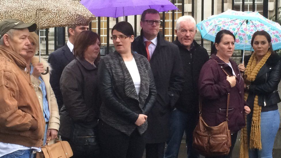 Families and legal representatives pictured outside court