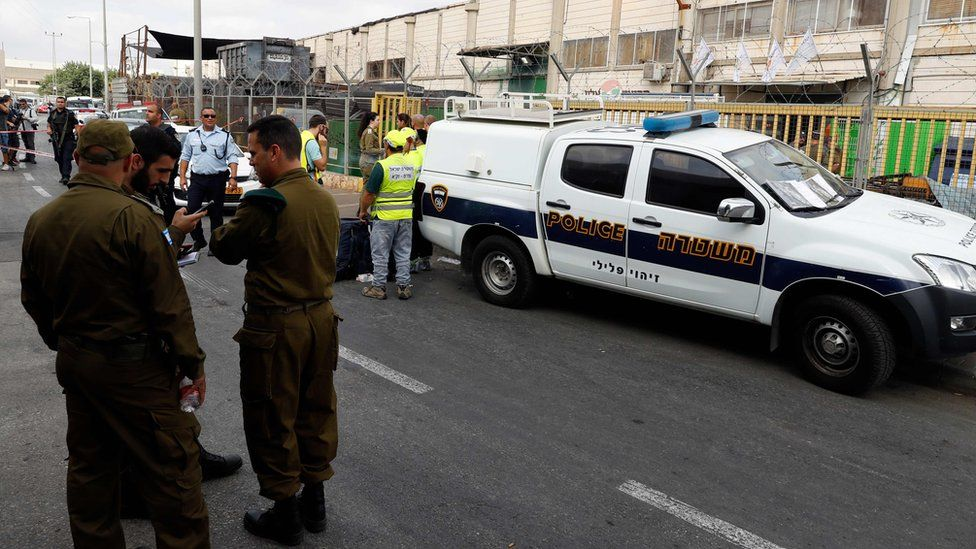 Israeli security forces personnel stand outside the factory in the Barkan Industrial Zone, in the occupied West Bank, where two Israelis were shot dead on 7 October 2018