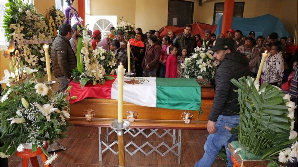 Relatives and friends gather around the coffin of environmental activist Homero Gomez, who fought to protect the famed monarch butterfly and was found dead two weeks after he disappeared, during his funeral service in the western Mexican state of Michoacan, Mexico January 30, 2020.