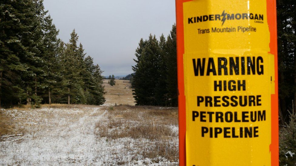 A sign warns of the presence of the Trans Mountain pipeline outside Kamloops, British Columbia