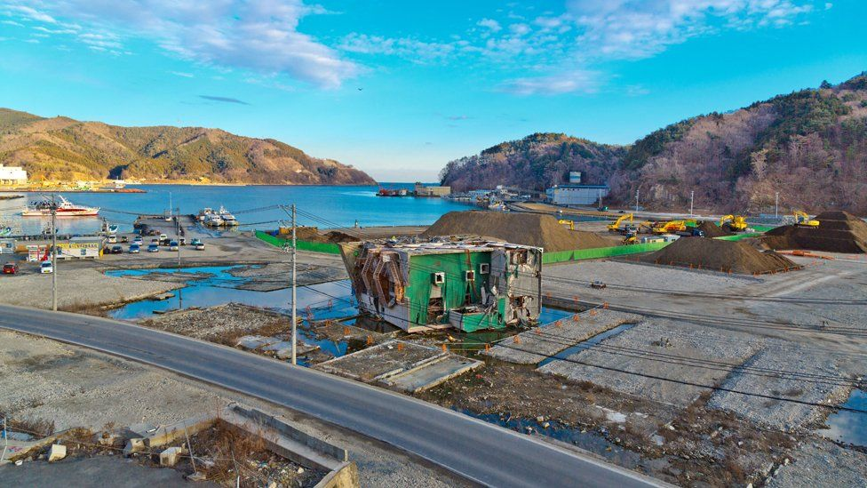 a toppled building in Onagawa port