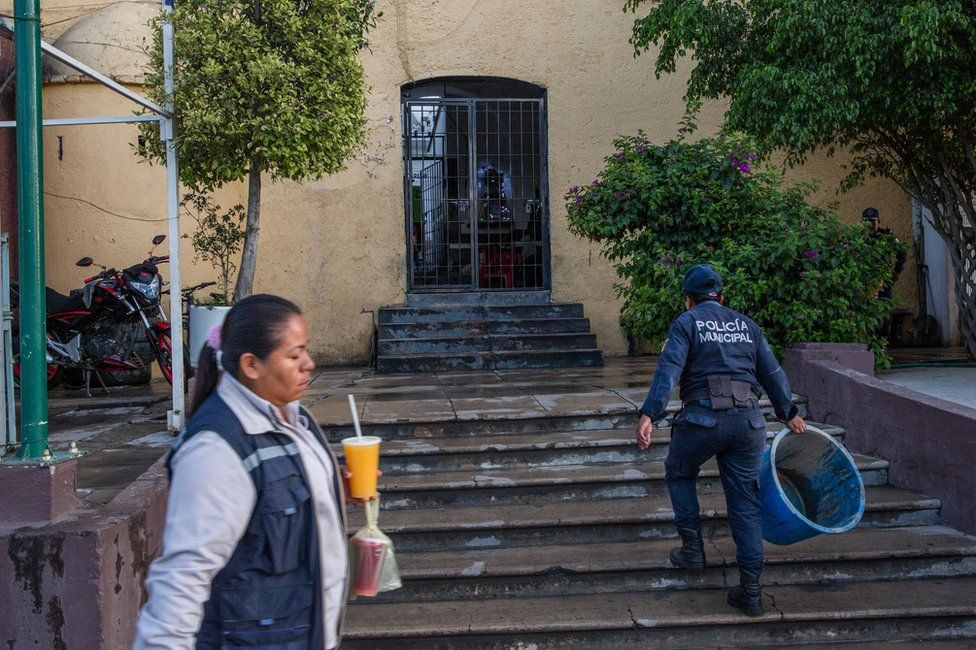 A municipal police officer walks into the local police station in Acatlán, Puebla