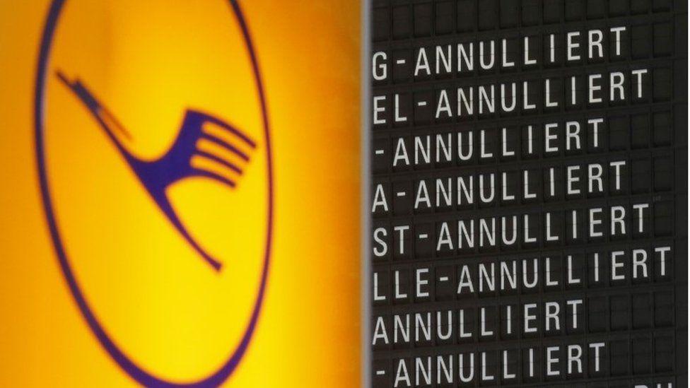 Lufthansa logo and cancellation flight board
