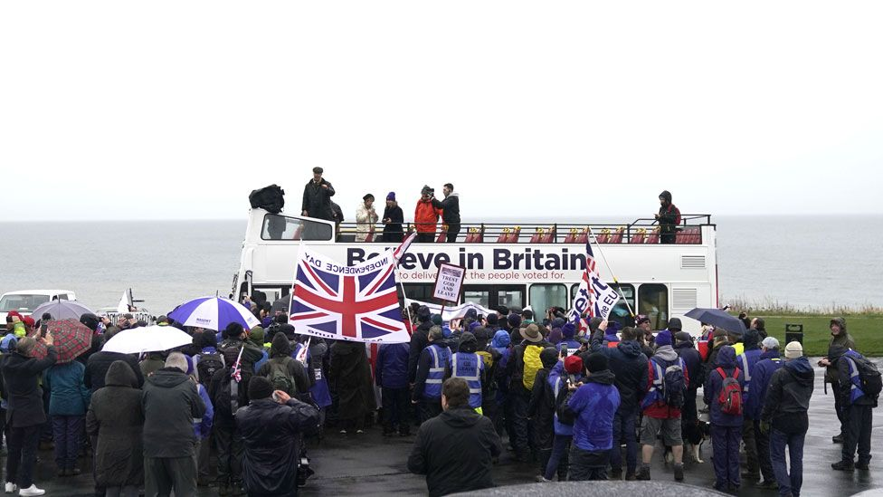 Nigel Farage makes a speech to marchers from the top of an open top bus