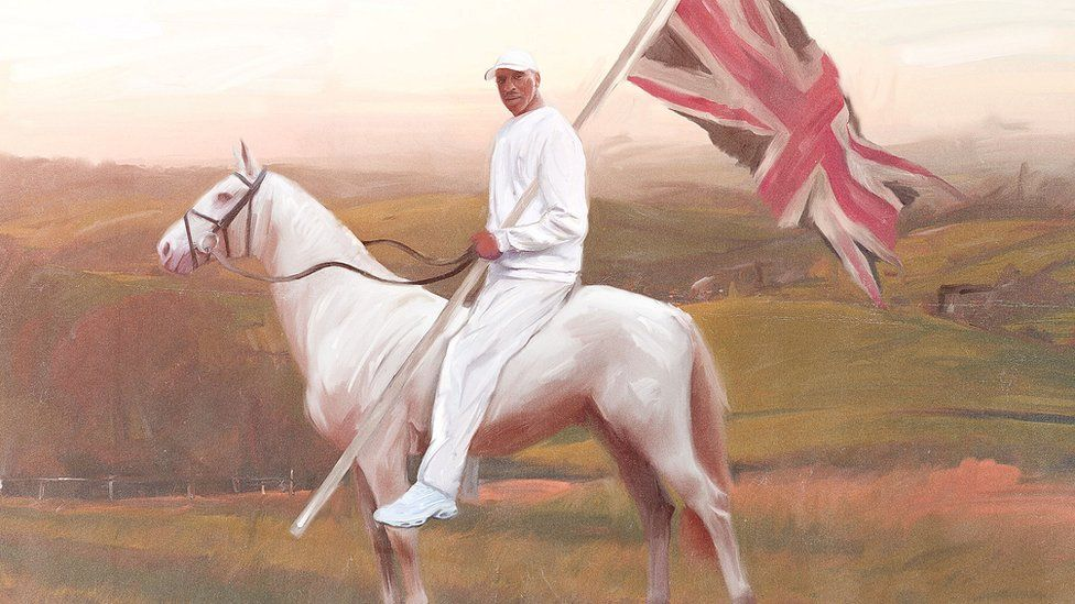 Skepta on top of a white horse carrying a union flag
