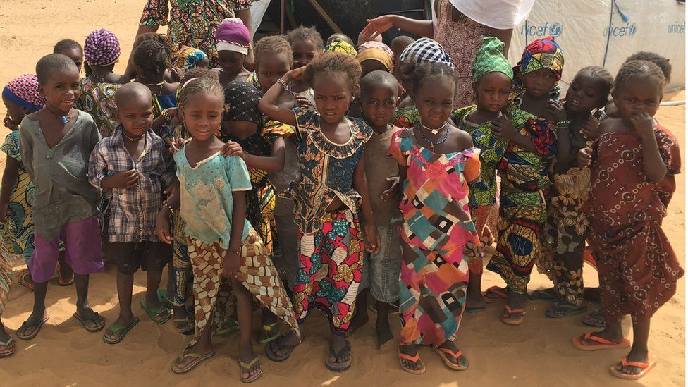 Children displaced by Boko Haram insurgency outside their makeshift school run by Unicef in a camp in Niger's Diffa region
