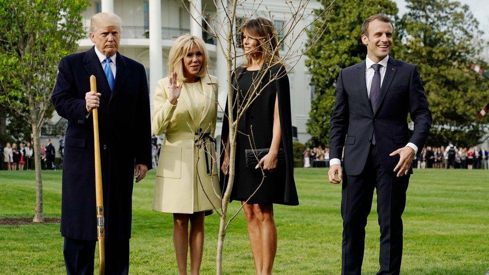 President Donald Trump, Brigitte Macron, Melania Trump and President Emmanuel Macron stand with the tree