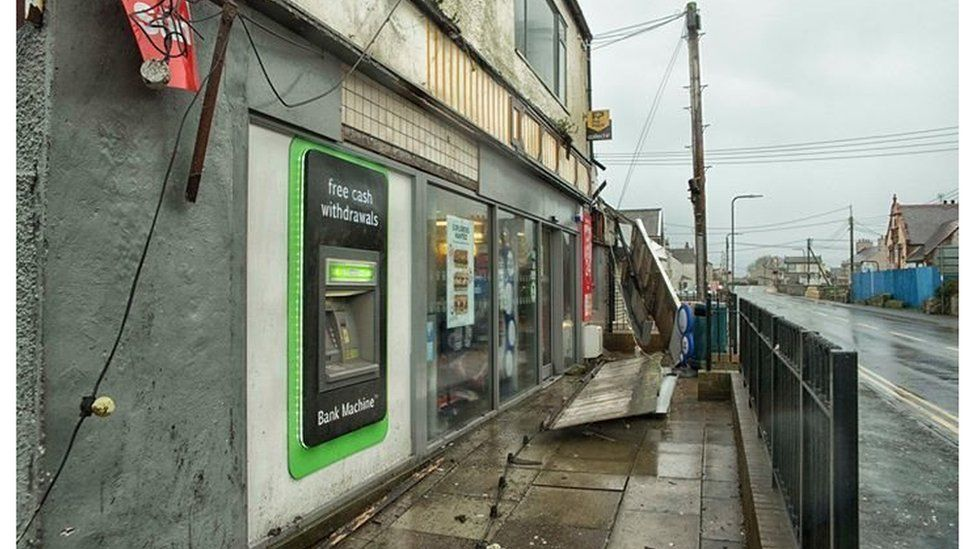 Shop front damaged at Valley on Anglesey