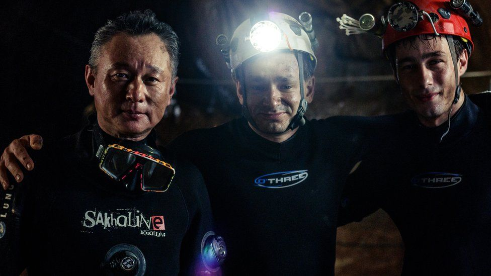 Cave divers Tan Xiaolong, Jim Warny and actor Alex Winslow on the set of The Cave