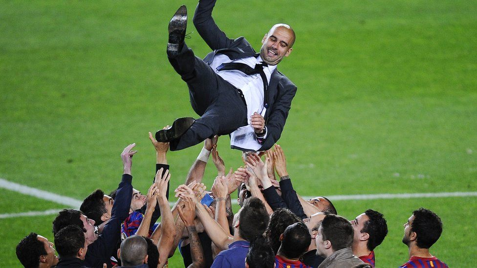 FC Barcelona players throw Josep Guardiola their head coach into the air at the end of the La Liga match between FC Barcelona and RCD Espanyol at Camp Nou 5 May 2012