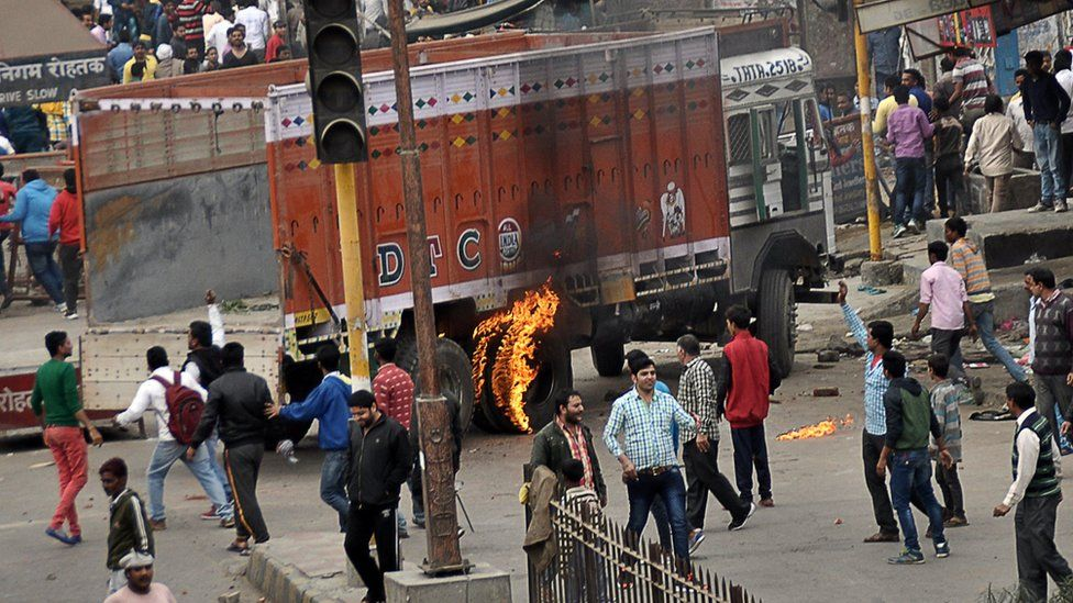 Protesters in India's Haryana state set fire to a vehicle