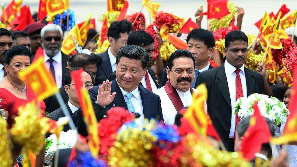China's President Xi Jinping and Sri Lankan President Mahinda Rajapakse at Bandaranaike International Airport, Sri Lanka, on 16 September 2014