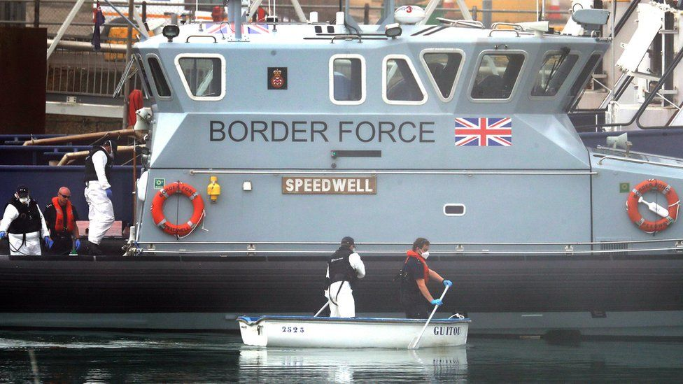 Border Force team with a small rowing boat