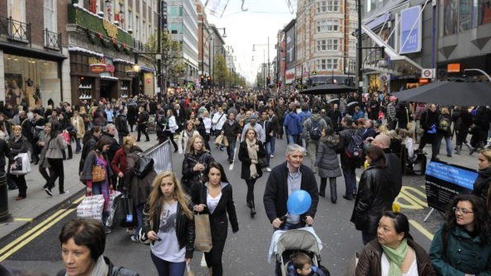 Shoppers walking up Oxford Street
