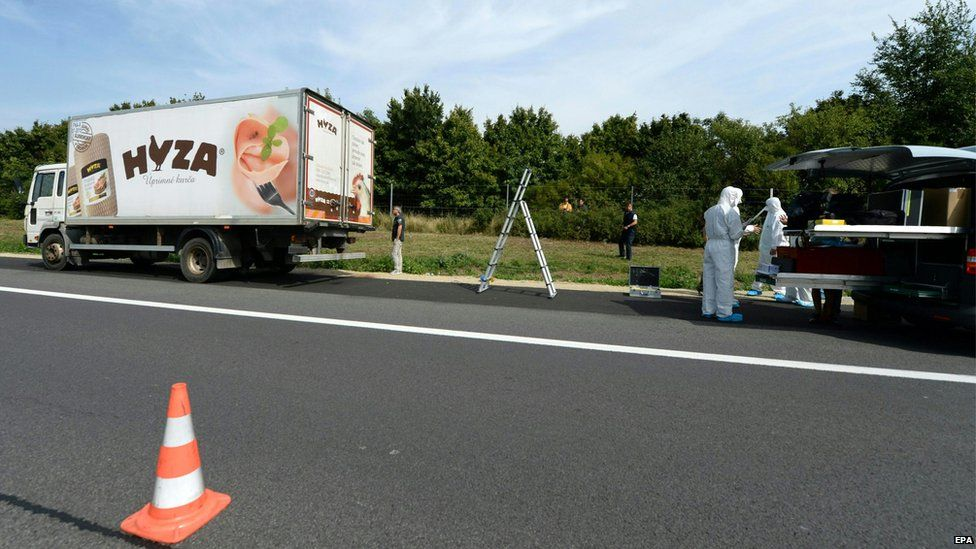 Forensic experts investigate a lorry in which refugees were found dead on autobahn A4 between Parndorf and Neusiedl, Austria, 27 August 2015