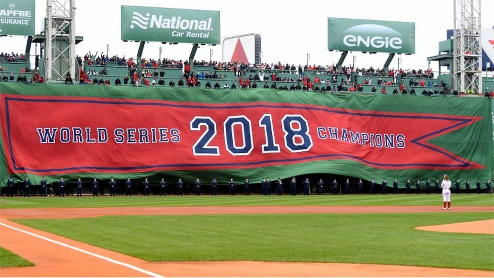 A 2018 World Series Champions banner is unrolled before a game between the Boston Red Sox and the Toronto Blue Jays during pregame ceremonies at Fenway Park.