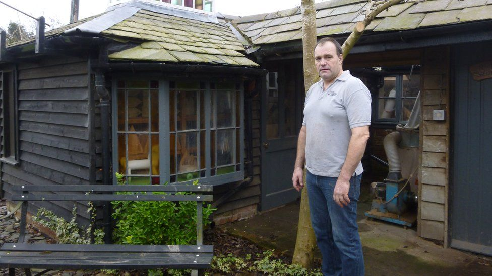 Richard Frost beside one of his four sheds