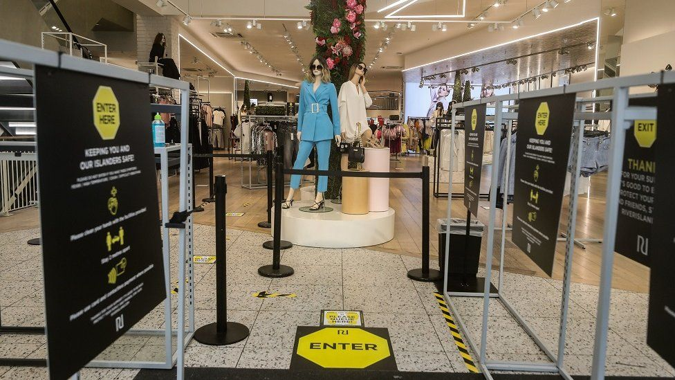 Signage reminding shoppers of social distancing rules in a River Island store in Liverpool, as shops make preparations to reopen following the introduction of measures to bring England out of lockdown.