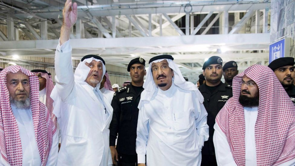 Saudi King Salman (centre) during a tour of the site where a crane fell inside the Grand Mosque in Mecca - 12 September 2015
