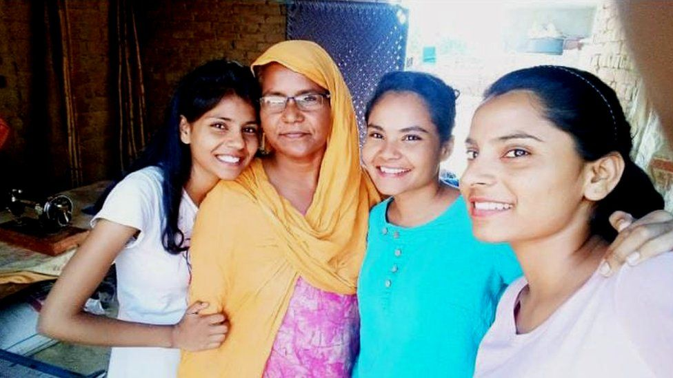 Nodeep Kaur with her mother and sisters