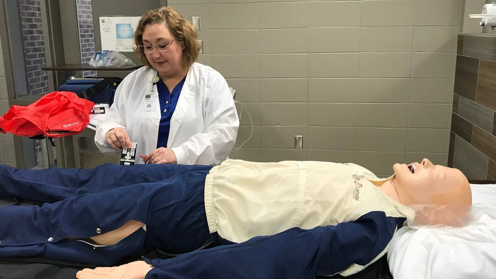 School nurse Treasa Daly demonstrates how an opioid antidote is used, in Shelby County, Alabama