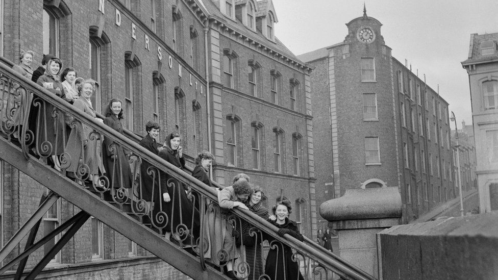 Workers leaving the Tillie and Henderson's shirt factory in November 1955