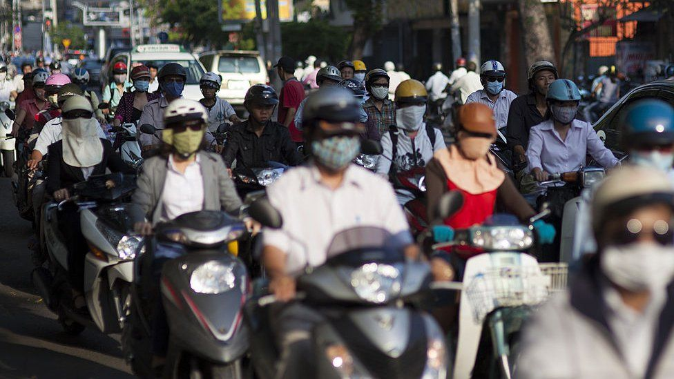 General view of commuters travelling on Scooters and motorbikes in Ho Chi Minh City, Vietnam
