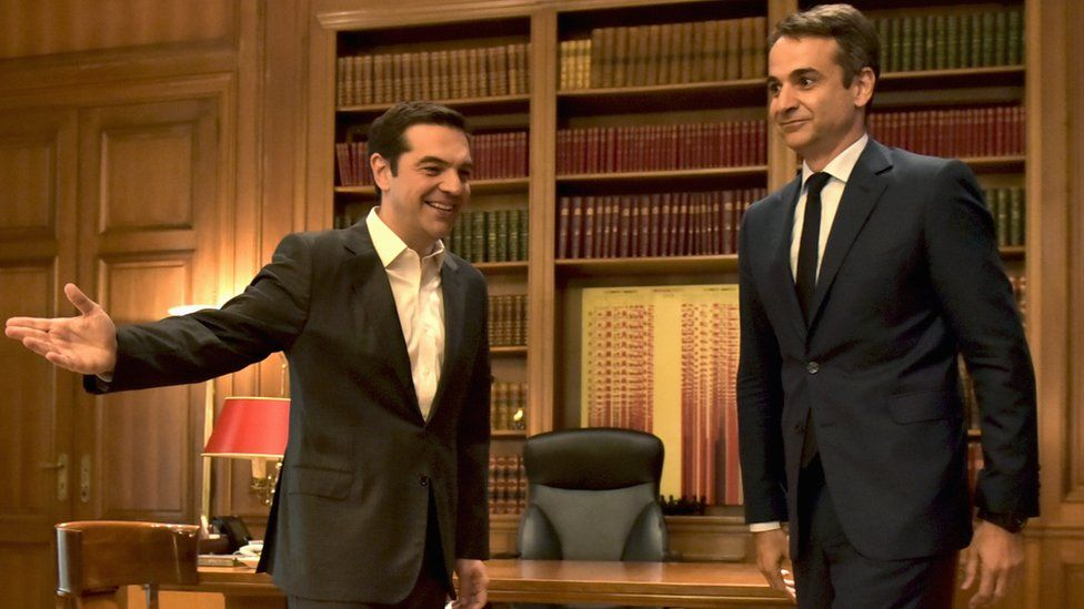Greek Prime Minister Alexis Tsipras (left) and leader of the New Democracy party, Kyriakos Mitsotakis