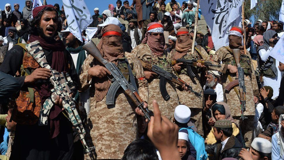 Afghan Taliban militants and villagers attend a gathering as they celebrate the peace deal in Afghanistan, in Alingar district of Laghman Province on March 2, 2020