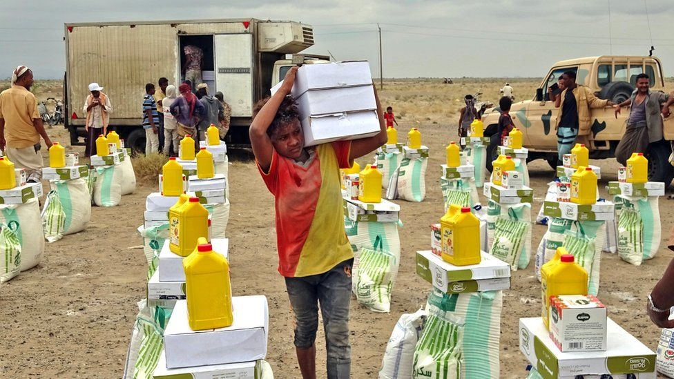 A boy transports food in the village of Hays near Yemen