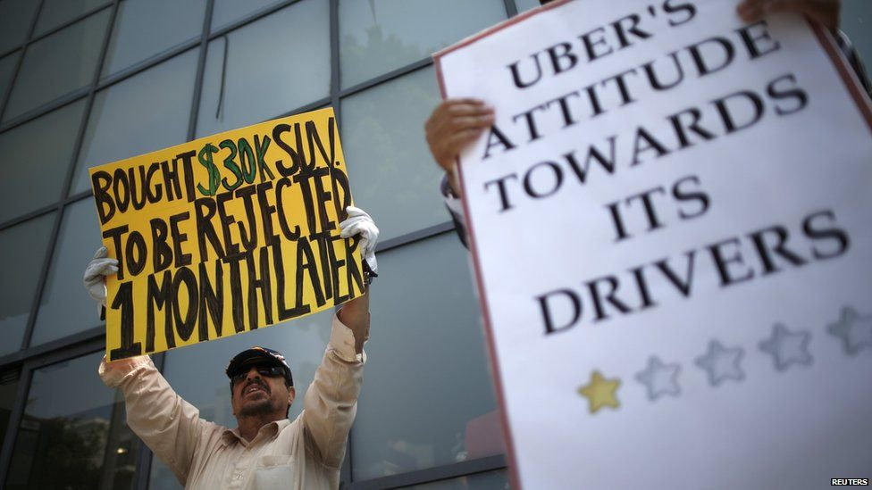 Drivers with Uber protest against working conditions outside the company's office in California