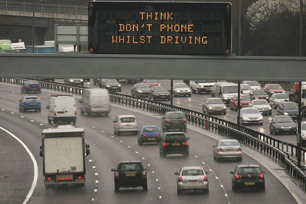 A motorway sign warns drivers not to use their mobile phones