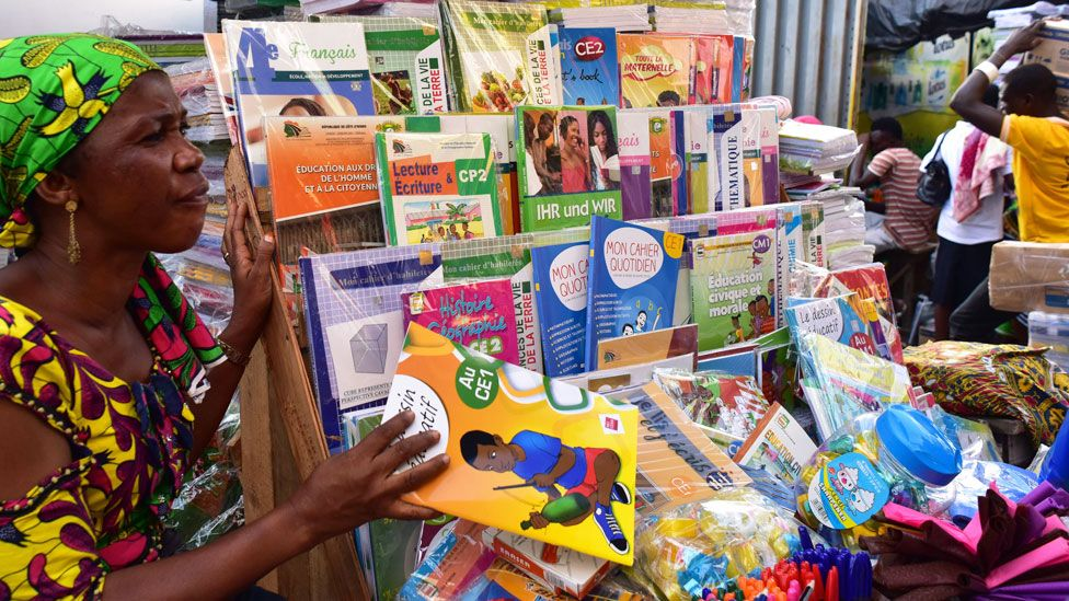 A woman selling French second-hand books in Abidjan, Ivory Coast