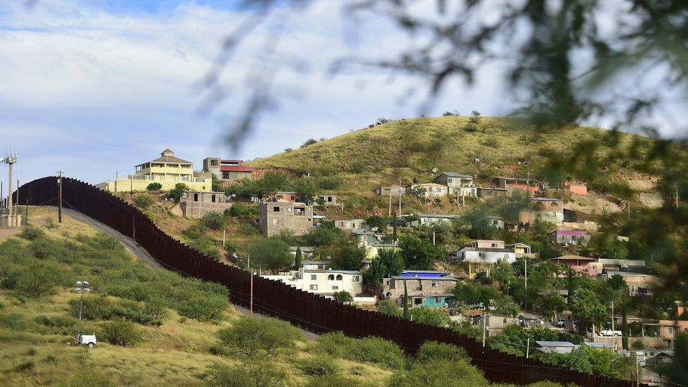 The border of the US-Mexico (houses and hills)